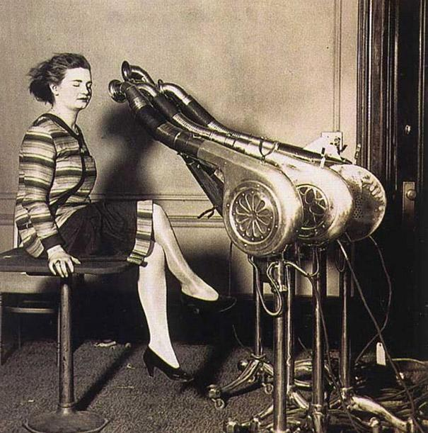A chorus of large blow-driers attends to a customer in the 1920s