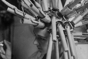 A permanent hair procedure (presumably hair waving) being performed in Germany in 1929