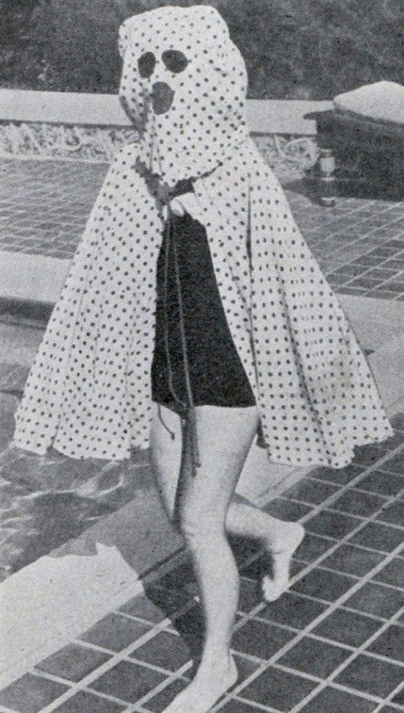 Before the invention of sun-screen in the mid 1940s, bathers wore garments like this Freckleproof Cape to protect themselves from the sun. The cape also features built-in sunglasses.