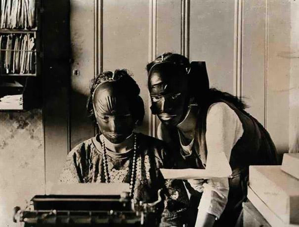 "These two 1920s women are getting rid of wrinkles and imperfections by wearing rubber ""beauty masks"""