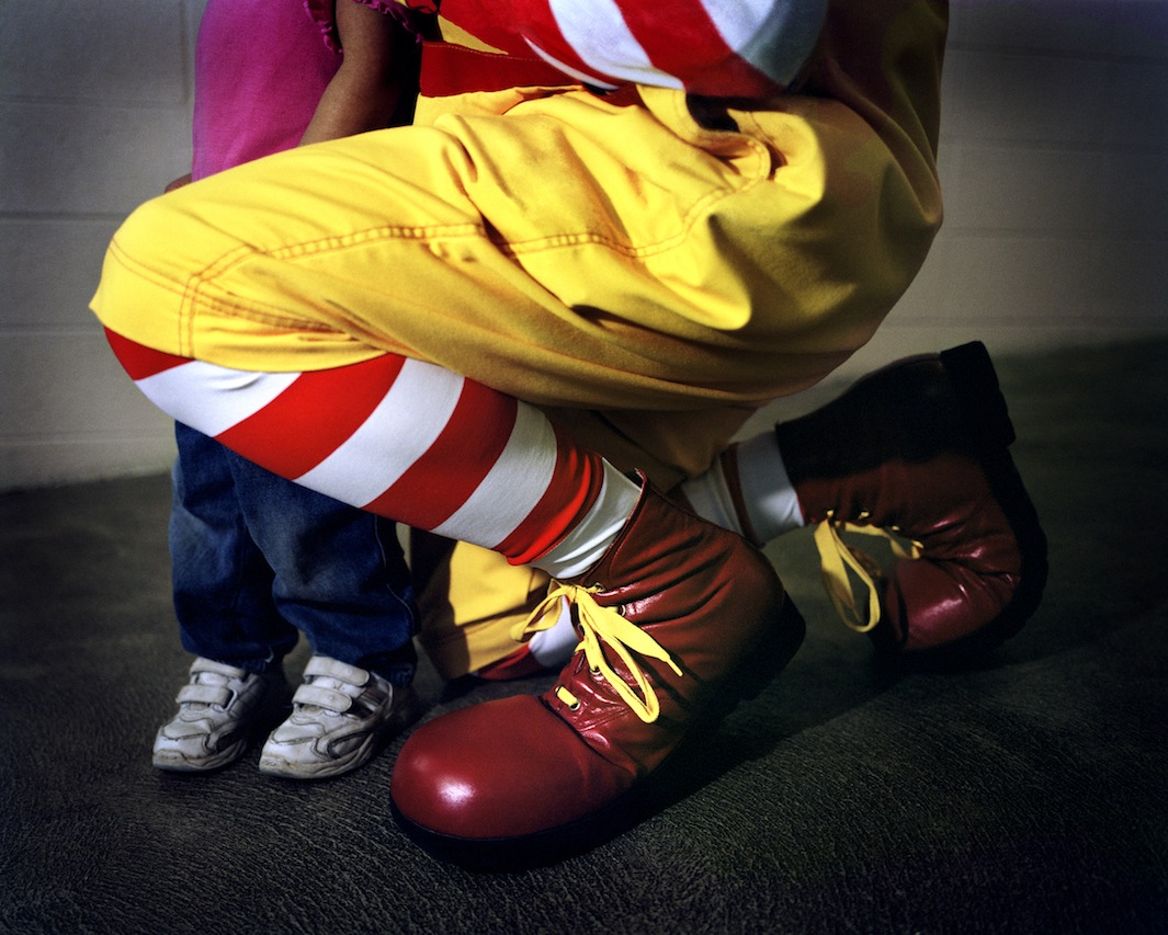 Ronald McDonald's feet and a young child's feet