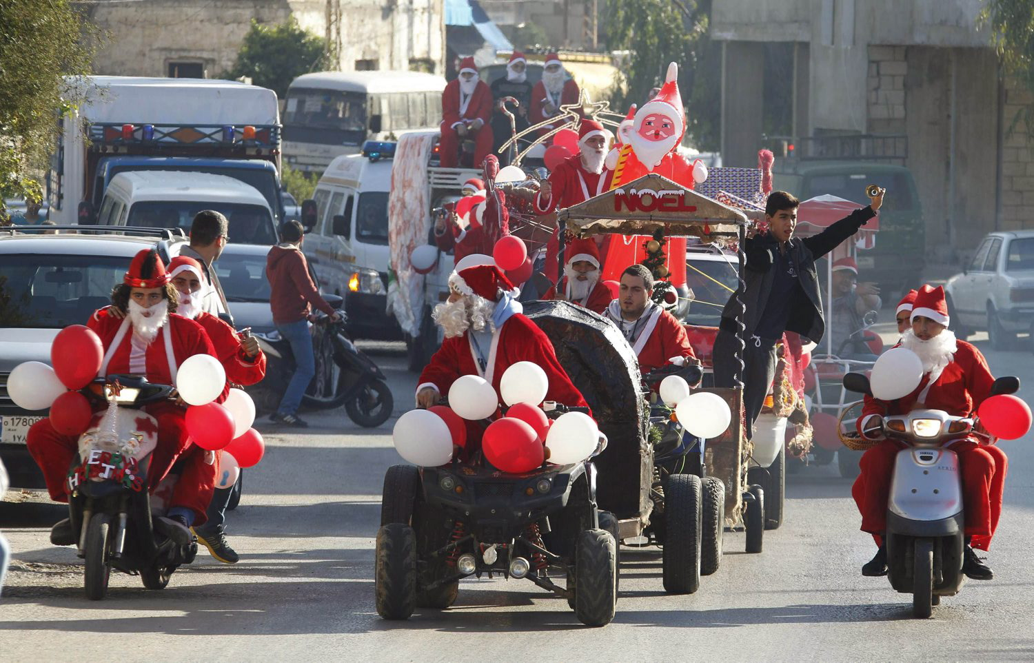 Lebanese Christians dressed as Santa Claus celebrate Christmas in Jiyeh village, south of Beirut