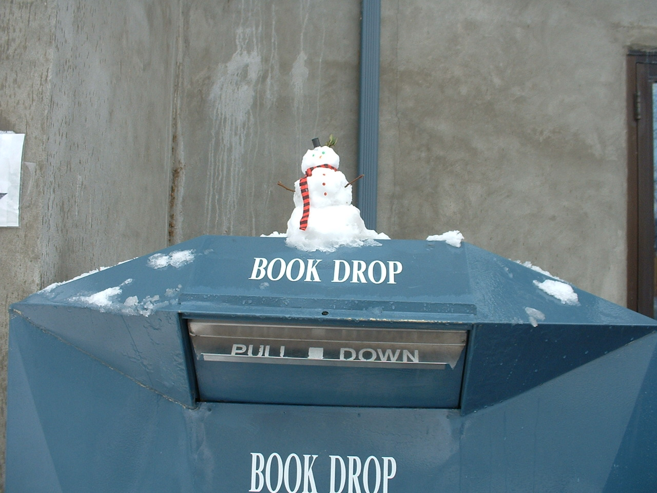 small-snowman-on-book-drop-by-ada-community-library