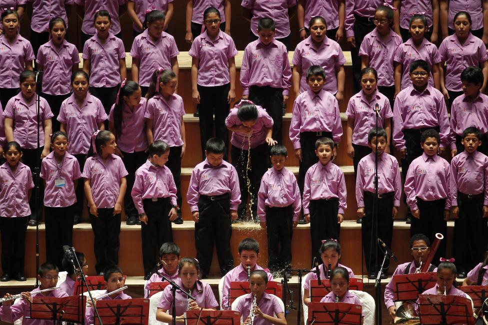 "A young member of the choir of ""Sinfonia por el Peru"" vomits before performing with Peruvian tenor Juan Diego Florez at Lima's National Theatre"