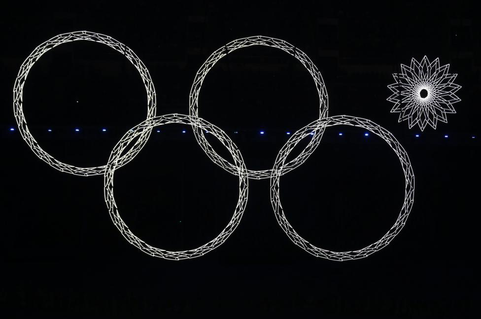 Four out of five Olympic rings are seen lit up during the opening ceremony of the 2014 Sochi Winter Olympics