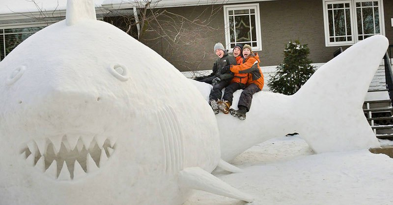 every-year-these-brothers-make-a-giant-snow-sculpture-on-their-front-lawn-3