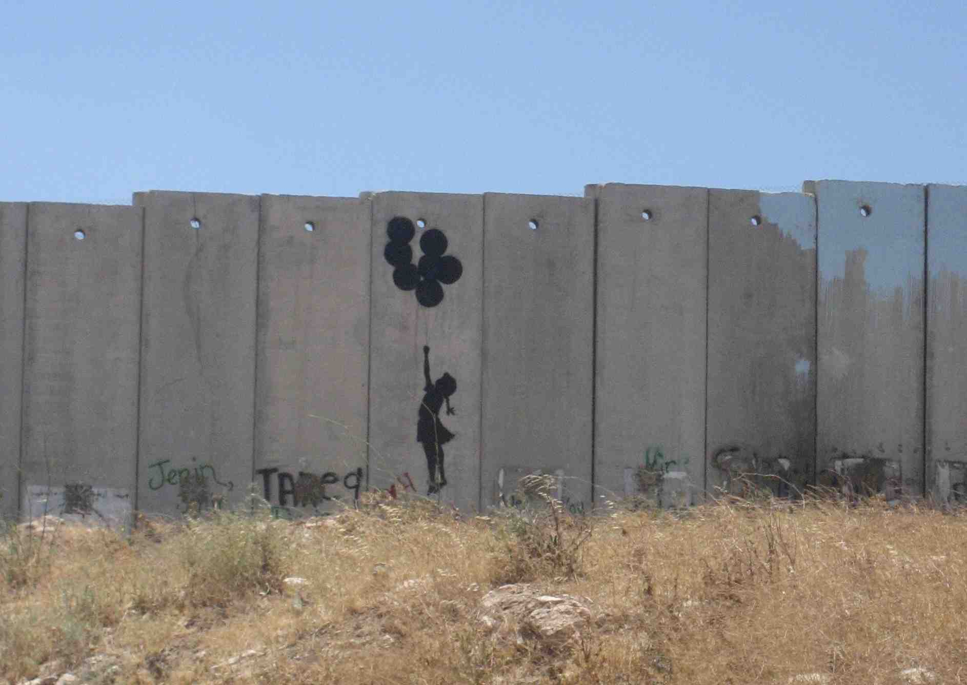 clever_graffiti_on_the_barrier_wall_between_israel_and_the_west_bank