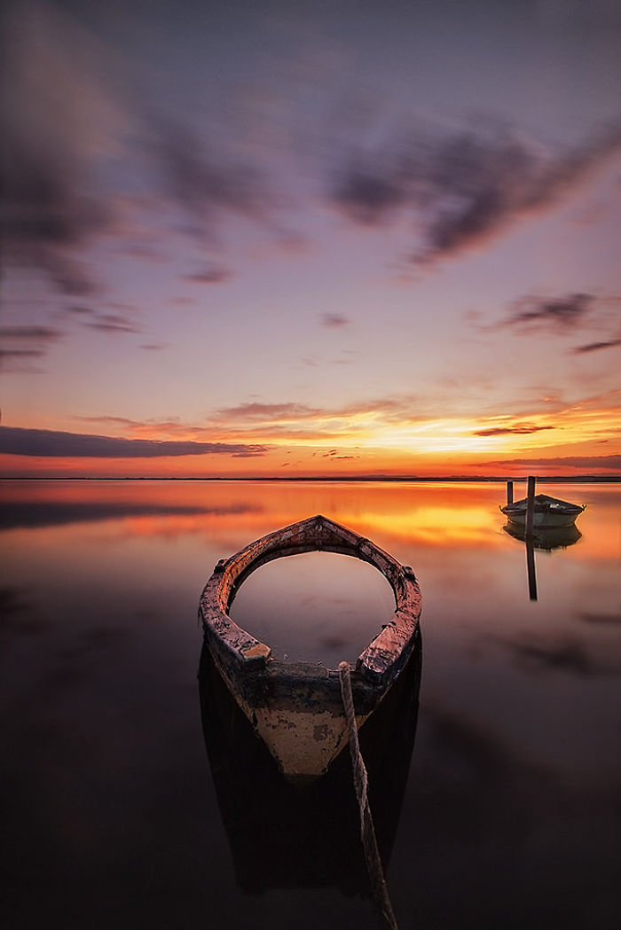 Floating-boat-at-sunset1__700