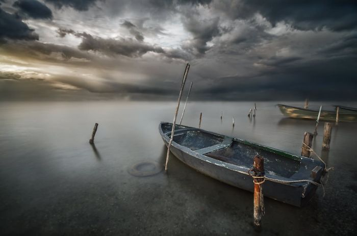 Floating-boat-at-sunset3__700