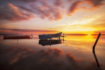 Floating-boat-at-sunset7__700