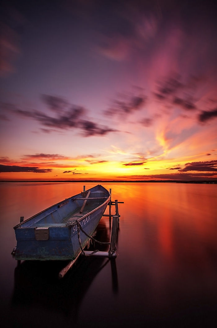 Floating-boat-at-sunset__700