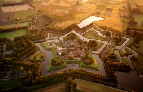 Three centuries after the last cannonball was fired in anger at the fort, it now serves as a museum and centre of a sleepy farming village in eastern Holland. The low, thick walls were designed to offset the pounding force of cannonfire.
