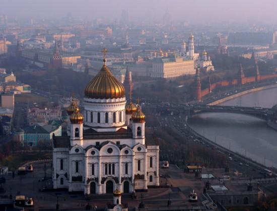 The Kremlin looms through the haze in background.