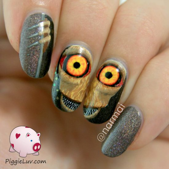piercing-eyes-creature-nail-art-1